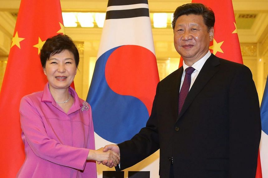 South Korean President Park Geun Hye (left) and Chinese President Xi Jinping held talks at the Great Hall of the People in Beijing, China, yesterday. Ms Park will be attending a parade in Beijing which marks the 70th anniversary of the end of World W