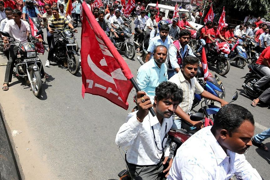 Trade unionists at a protest rally against the BJP's proposed labour reforms in Bangalore yesterday. The one-day strike caused major disruptions in transport, banking and industrial activity.