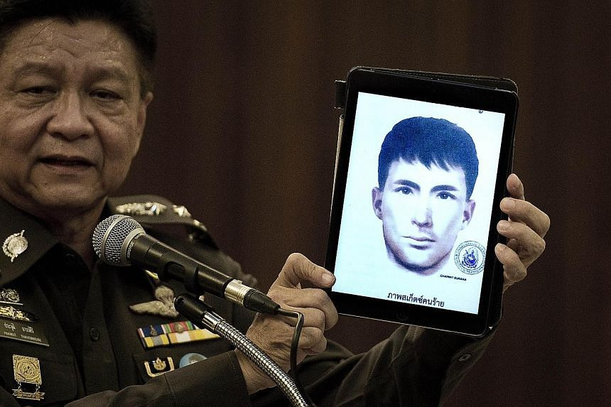Thailand's national police spokesman Prawut Thavornsiri with a tablet displaying a picture of Ali Jolan, a foreign man wanted in connection with the Aug 17 bombing of the Erawan Shrine in Bangkok. Thai police have issued an arrest warrant for Turkish