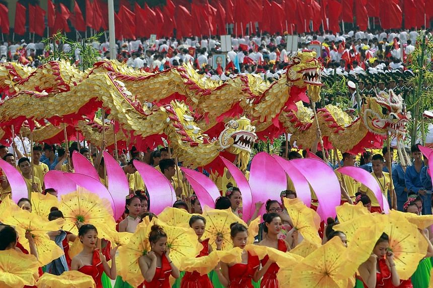 Performers taking part in a dragon dance during the parade marking Vietnam's 70th National Day at Ba Dinh square in Hanoi yesterday. More than 30,000 people, from soldiers to schoolgirls, marched in a lavish parade that was one of the country's large
