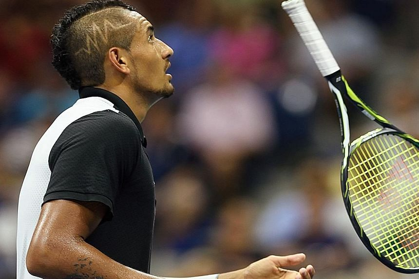 Nick Kyrgios tosses his racket during his four-set loss to Andy Murray in the first round of the US Open yesterday.