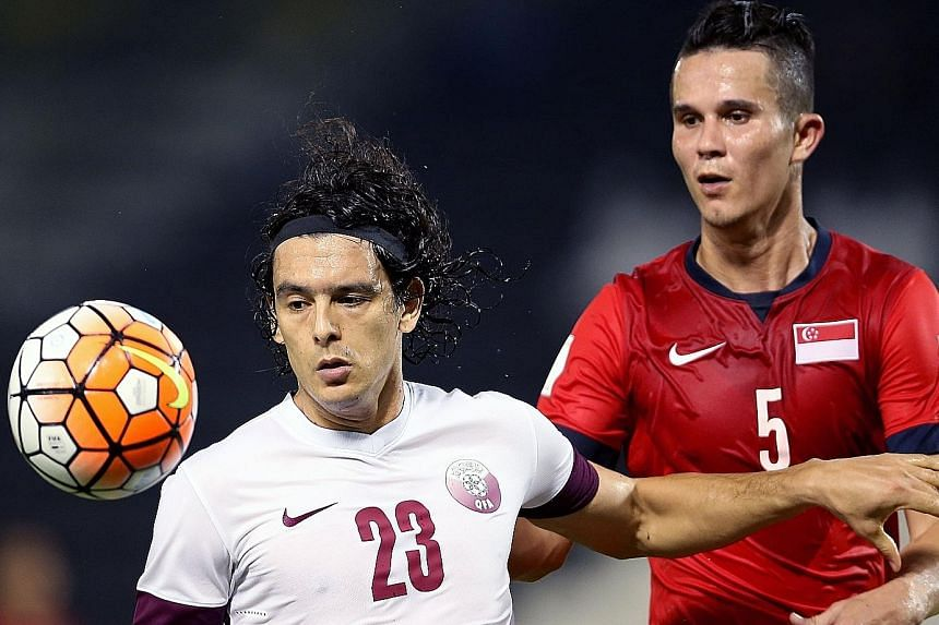 Singapore, with defender Baihakki Khaizan (right) in action against Qatar's Sebastian Soria, showed their defensive mettle in the first half before fatigue sapped them in the second half. The Lions eventually lost 0-4 in the friendly in Doha last Fri
