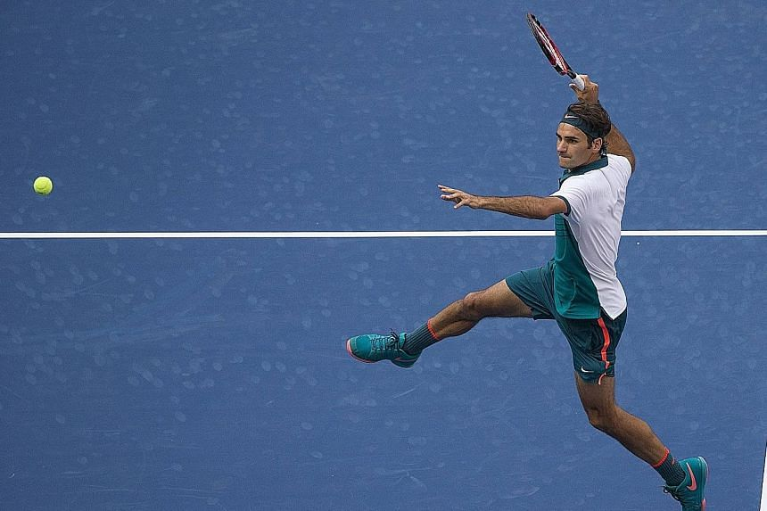 World No. 2 Roger Federer of Switzerland is airborne as he prepares to hit a smash during his 6-1, 6-2, 6-2 victory against Leonardo Mayer of Argentina in the first round of the US Open.