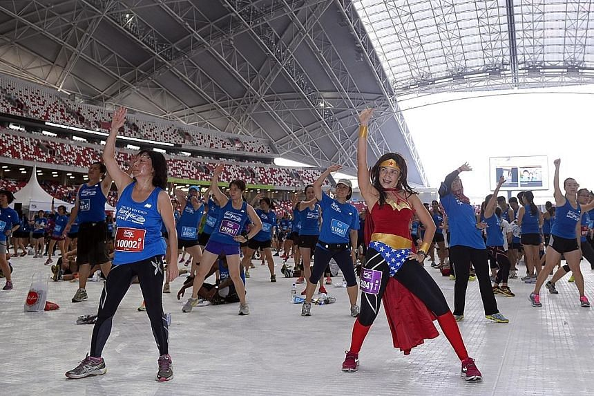 Last year, participants in The Straits Times Run at the Hub took the opportunity to burn more calories with a zumba workout.