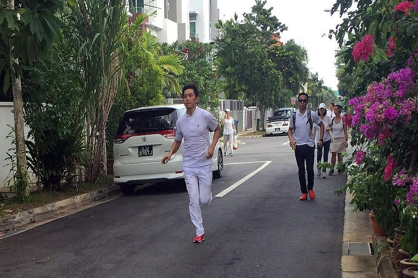 Mr Tan Chuan-Jin, PAP candidate for Marine Parade GRC, ran from house to house in order to meet more residents in their homes.