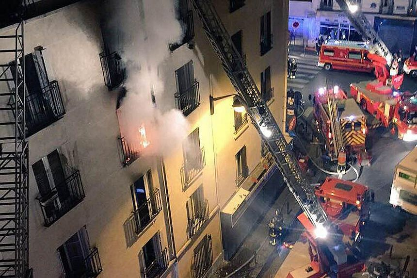 Firemen fighting a blaze that killed eight people, including two children, at an apartment building in north Paris early yesterday. Officials say the fire in the 18th district of the French capital might have been started intentionally. Investigators