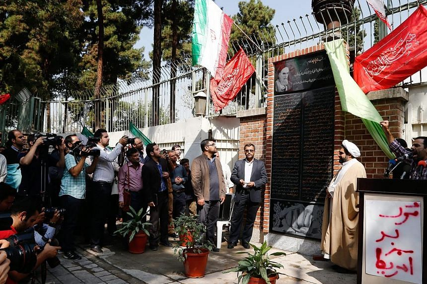 Anti-US comments written on a wall of the former US embassy in Teheran, which was unveiled yesterday. The unease expressed by Mr Barack Obama's supporters underscored the political agony the nuclear deal has created for lawmakers, particularly within