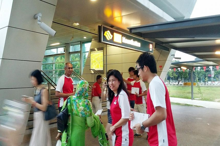 Left: PAP candidate Lim Biow Chuan meeting residents in Jalan Batu. Right: SPP candidate Jeannette Chong-Aruldoss handing out fliers outside Mountbatten MRT station with campaign volunteers. Both candidates have been working hard in the constituency