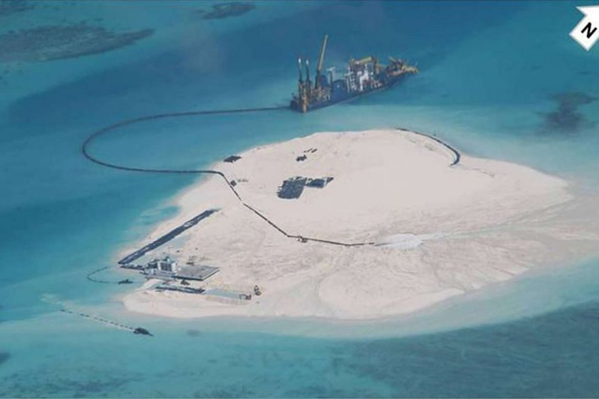 A photograph dated Feb 25, 2014 of the Johnson South Reef in the disputed South China Sea which reportedly shows reclamation done by China. The Philippines and Vietnam have been increasingly leaning on each other as they confront China.