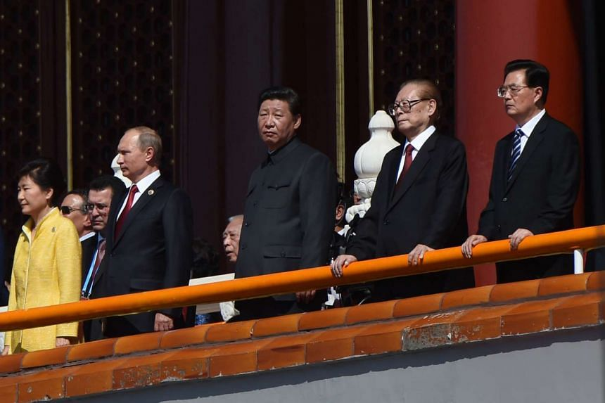 Chinese President Xi Jinping (centre) and guests Russian President Vladimir Putin (second from left) and South Korean President Park Geun-Hye (far left) and other dignitaries watch a military parade at Tiananmen Square in Beijing on Sept 3, 2015.