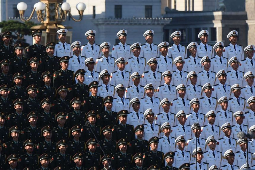 A Chinese military choir stands in position ahead of the military parade.