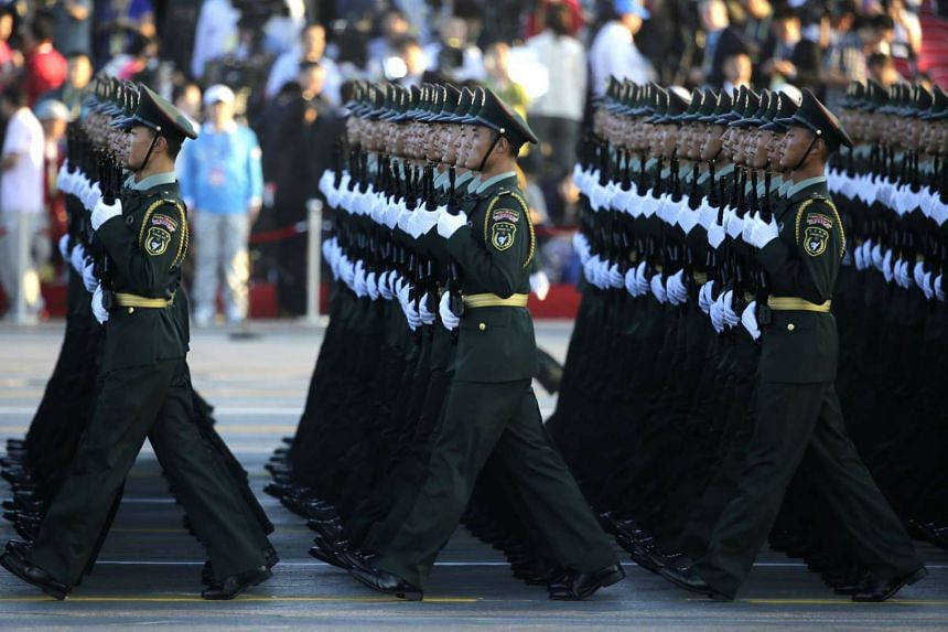 Soldiers of China's People Liberation Army prepare in front of the Tiananmen Gate.