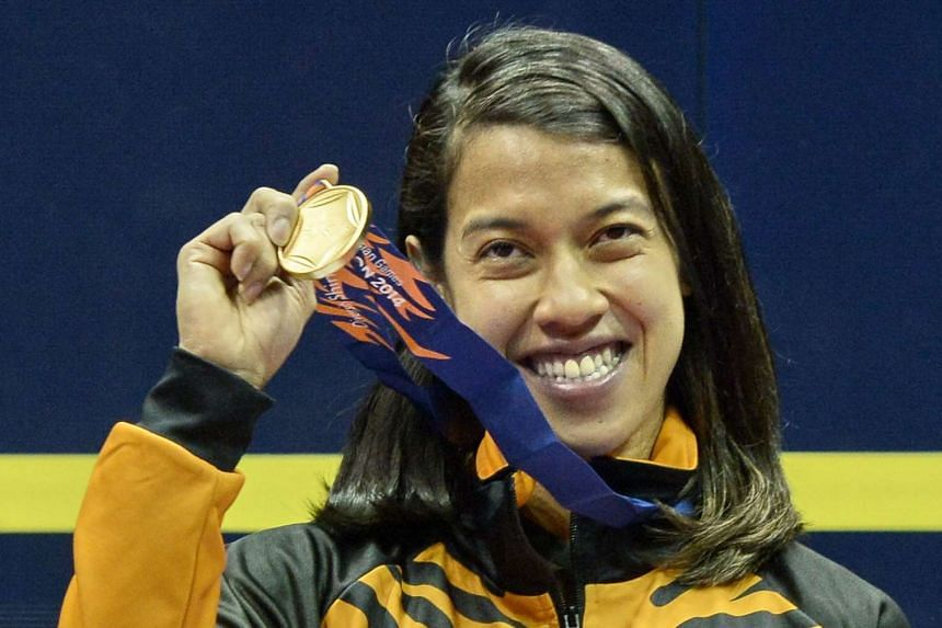 Malaysia's Nicol David posing with her gold medal after defeating compatriot Wee Wern Low in the women's individual squash finals at the 2014 Asian Games in Incheon.
