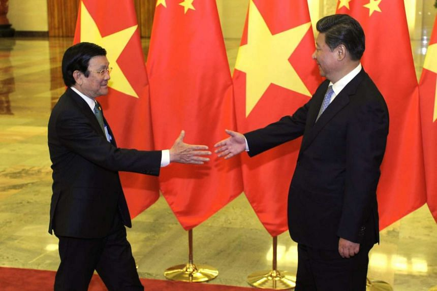 Chinese President Xi Jinping (right), greeting Vietnamese President Truong Tan Sang before their meeting at the Great Hall of the People in Beijing, China, on Sept 3, 2015.