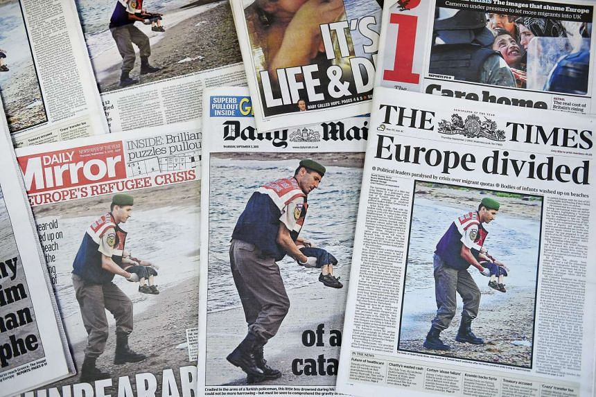 A picture of Turkish gendarmerie carrying the body of a child at the beach of Bodrum, Turkey dominates the front pages of British newspapers in London, Britain, on Sept 3, 2015.
