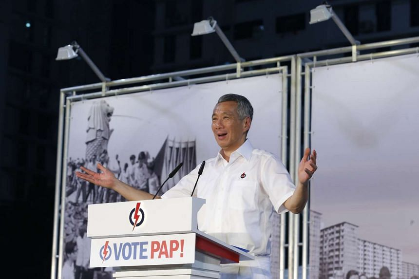 Prime Minister Lee Hsien Loong speaking at the PAP rally at Delta Sports Complex on Sept 2. ST PHOTO: LAU FOOK KONG