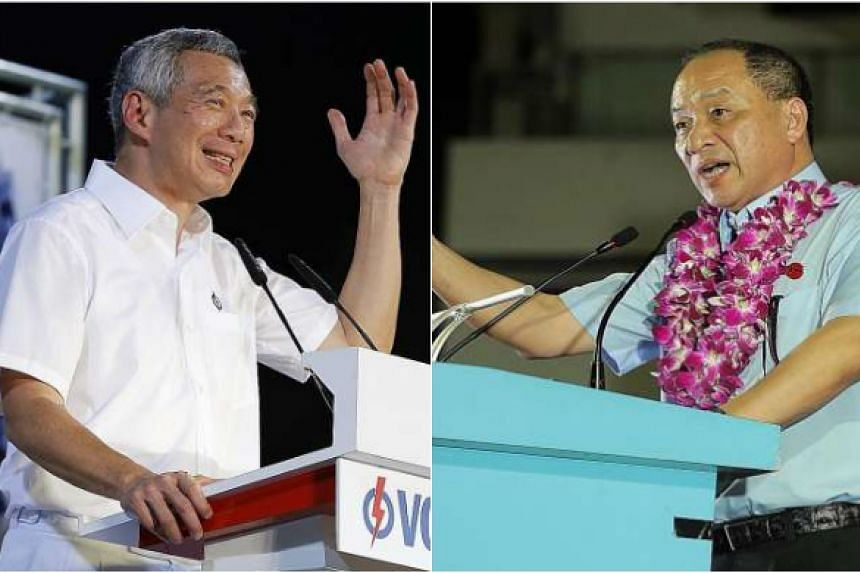 """In Tanjong Pagar, Prime Minister Lee Hsien Loong (left) outlined the People's Action Party's plan to transform the area, including building a Southern Waterfront City that is """"three times the size of Marina Bay, and three times as beautiful"""". In Houg"""