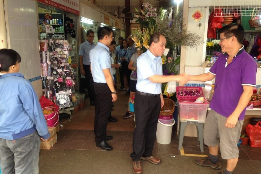 Mr Low Thia Khiang opted for hiking boots as he met residents at the New Upper Changi Road Market and Food Centre on Thursday (Sept 3) morning.