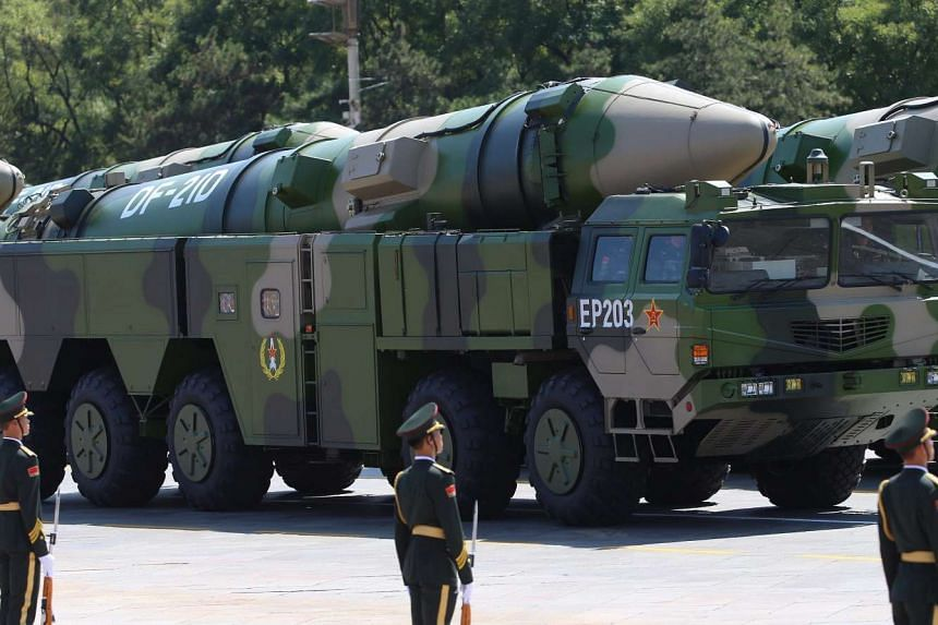 A Dong Feng DF-21D anti-ship ballistic missile launchers move through Tiananmen Square during a military parade marking the 70th Anniversary of the end of World War II, in Beijing, China, on Sept 3, 2015.