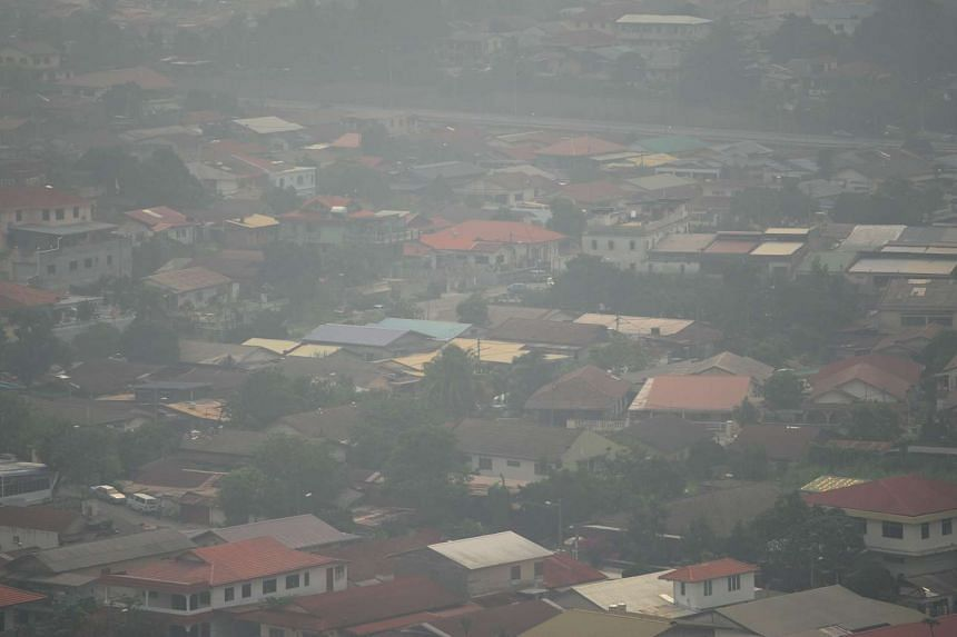 Residential houses are seen obscured by haze from the Hulu Langat hill in Ampang on Sept 2, 2015.