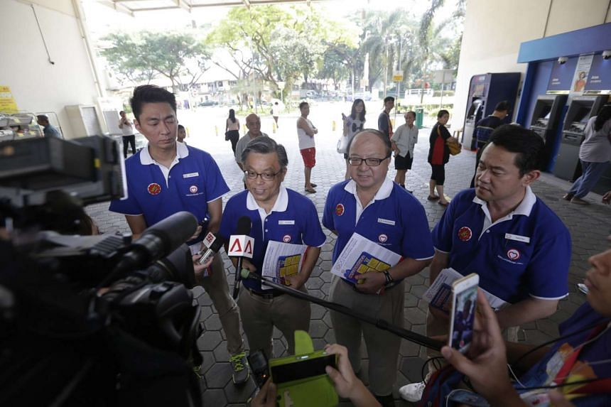 SingFirst candidates for Tanjong Pagar GRC (from left) Melvyn Chiu, Tan Jee Say, Ang Yong Guan and Fahmi Rais speaking to the media during a walkabout in Commonwealth on Sept 2, 2015.