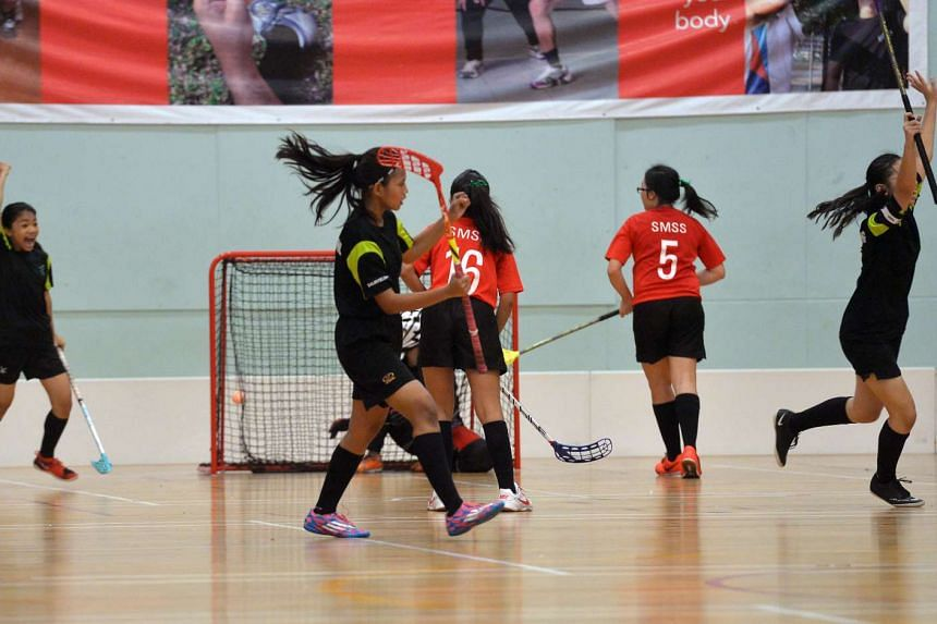 No let-up for the Tanjong Katong girls' floorball team (in black) as they beat St Margaret's 6-2 in the Schools National C Division final for the title.