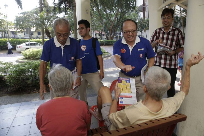 A SingFirst candidate for Tanjong Pagar GRC, Dr Ang Yong Guan (second from right), and party supporters interacting with residents during a walkabout.