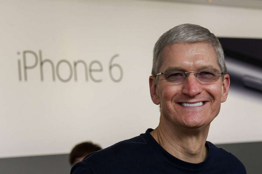 Tim Cook, chief executive officer of Apple Inc., stands for a photograph during the sales launch for the iPhone 6 and iPhone 6 Plus at the Apple Inc. store in Palo Alto, California, United States, on Friday, Sept 19, 2014.