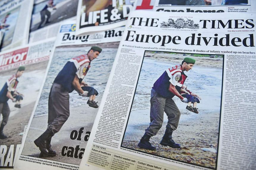 A picture of Turkish gendarmerie carrying the body of a child at the beach of Bodrum, Turkey dominates the front pages of British newspapers in London, Britain, Sept 3 2015.