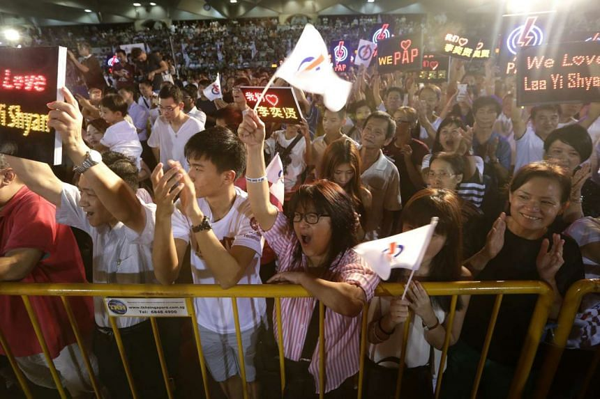 Supporters cheering for the People's Action Party's East Coast GRC team at a rally at Bedok Stadium on Sept 3, 2015.