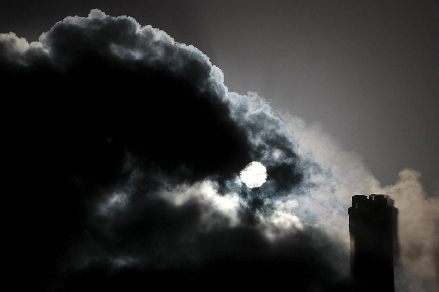 The sun is seen through the steam and other emissions coming from funnels of the brown coal Loy Yang Power Station in the Latrobe Valley near Melbourne in this Dec 15, 2008 file photograph.