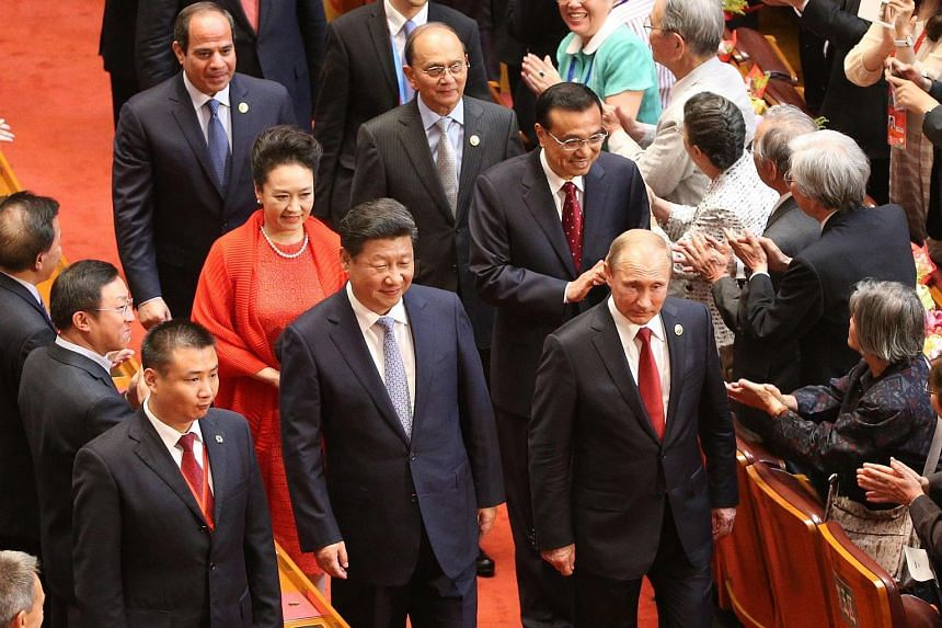 Chinese President Xi Jinping (left) and Russia's President Vladimir Putin (right) attend the gala marking the 70th Anniversary of the Victory of Chinese People's Resistance against Japanese Aggression and World Anti-Fascist War at the Great Hall of t
