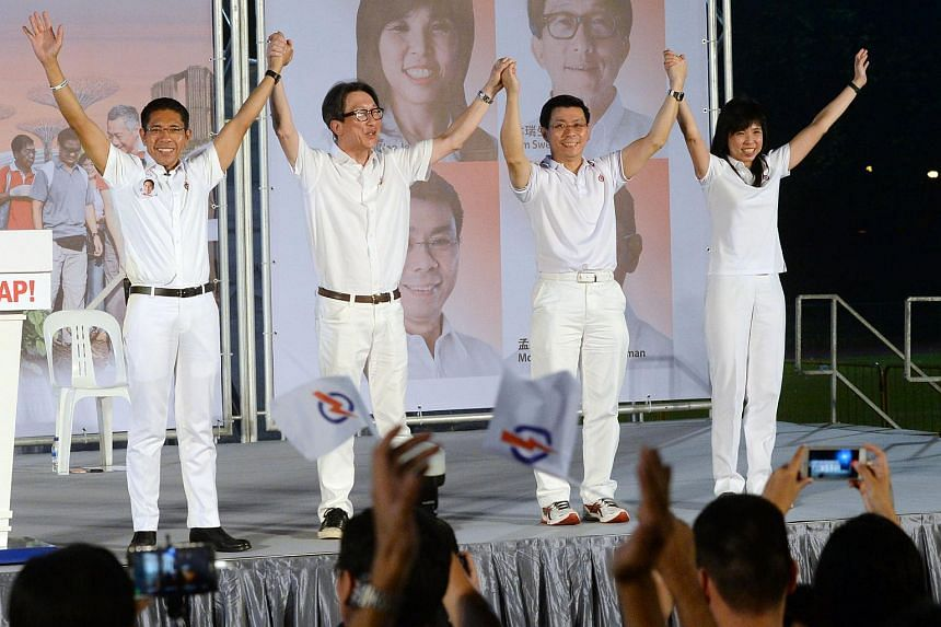PAP's East Coast GRC candidates (from left) Dr Maliki, Mr Lim Swee Say, Mr Lee Yi Shan and Ms Jessica Tan during a PAP rally at Bedok Stadium on Sept 3, 2015.