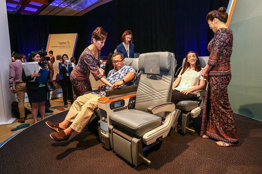 Visitors at the media launch of SIA premium economy product at Marina Bay Sands, where the new premium economy seats were displayed for the first time.