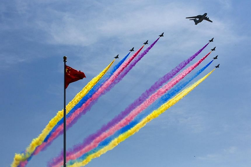 An aerial display during a military parade marking the 70th anniversary of the end of World War II, seen in Beijing on Sept 3.