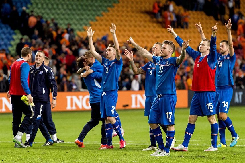 Iceland's players celebrating their victory after the UEFA Euro 2016 qualifying round soccer match between the Netherlands and Iceland at the Arena Stadium, in Amsterdam, The Netherlands on Sept 3, 2015.