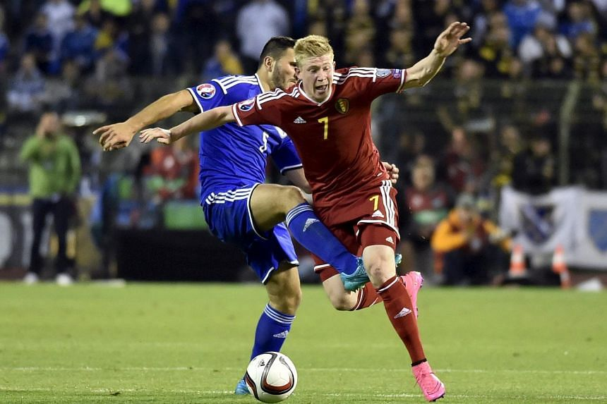 Belgium's Kevin De Bruyne (right) fighting for the ball against Bosnia's Sead Kolasinac during their Euro 2016 qualifying soccer match in Brussels, Belgium on Sept 3, 2015.