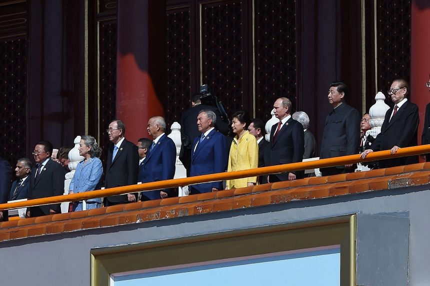 The leaders gathered at the parade included Chinese President Xi (third from right), Russian President Vladimir Putin (fourth from right) and South Korean President Park Geun Hye (in yellow).