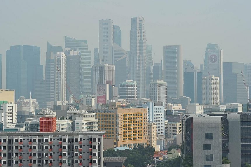 The city skyline at 4.30pm yesterday. The three-hour PSI at 4pm was 94, according to the NEA website. Air quality is considered unhealthy if the index crosses 100. Given the haze forecast, the NEA advised people to reduce outdoor activities and physi