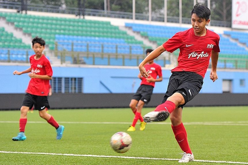 Singapore Under-16s' Glenn Kweh (right) taking shots during training for the AFC (U-16) Championship.