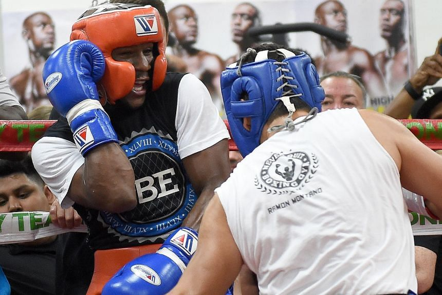 Floyd Mayweather (left) sparring with boxer Ramon Montano during a workout at the Mayweather Boxing Club in Las Vegas last month. The American pound-for-pound king is set for his last fight on Sept 12.