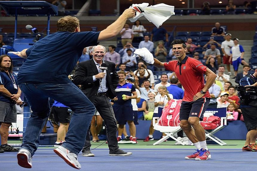 Novak Djokovic (right) gives his fans more to cheer about, dancing with an entertainer after beating Andreas Haider-Maurer.