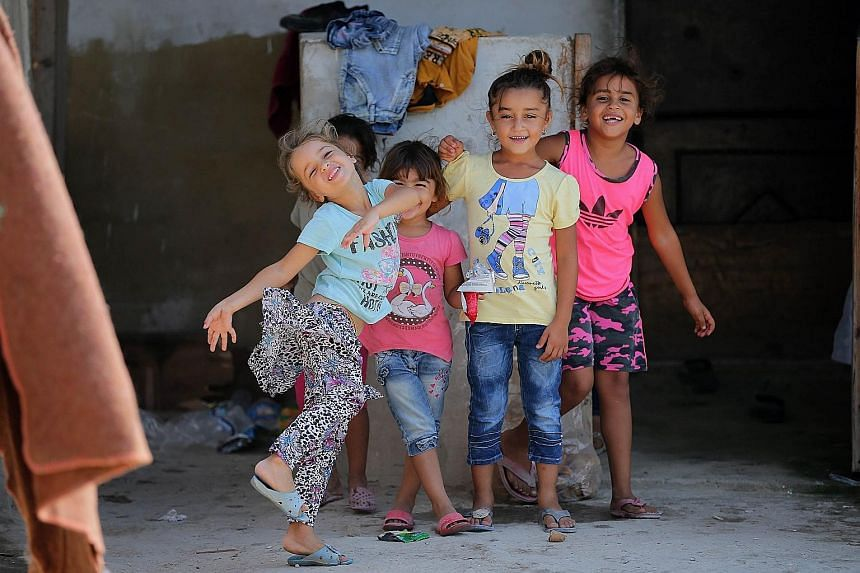 Syrian refugee children playing at an unofficial refugee camp in the northern Lebanese city of Tripoli, north of capital Beirut, on Wednesday.