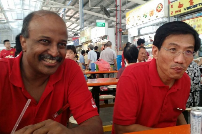 Dr Chee (right) speaking to The Straits Times at Ghim Moh market with teammate Paul Tambyah.