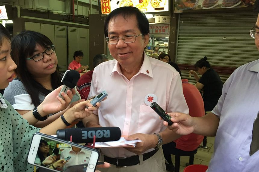 NSP's Mr Cheo Chai Chen speaks to reporters at 89 Pipit Road before the start of his walkabout at the hawker centre and wet market.
