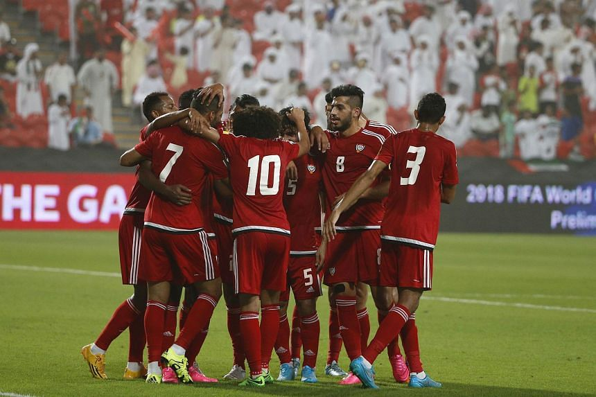 UAE's players celebrate after scoring a goal against Malaysia's team during their AFC qualifying football match for the 2018 FIFA World Cup at the Mohammed Bin Zayed Stadium in Abu Dhabi on Sept 3, 2015.
