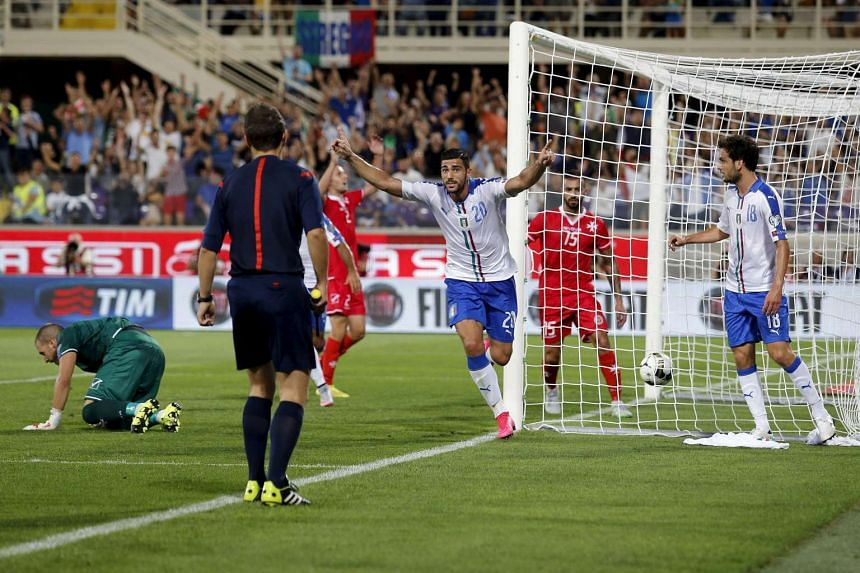 Italy's Graziano Pelle (centre) celebrates after scoring against Malta during their Euro 2016 qualification match at the Franchi stadium in Florence, Italy on Sept 3, 2015.