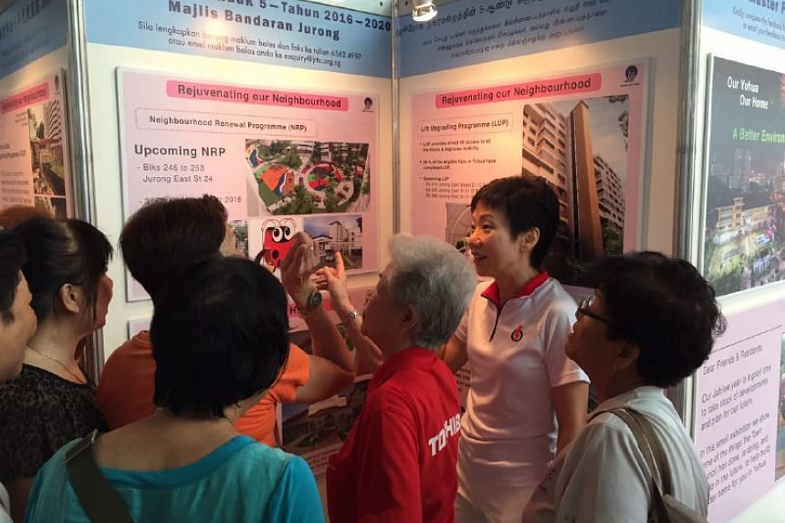 PAP's Yuhua candidate Grace Fu explaining the five-year masterplan to residents.