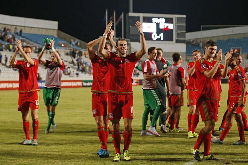 Gareth Bale and team mates celebrate at the end of the UEFA Euro 2016 Qualifying Group B match on Sept 3, 2015.