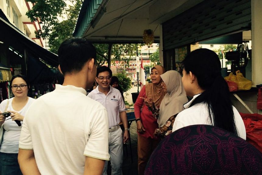 Mr Heng Swee Keat (centre) speaking with Tampines residents during his walkabout.